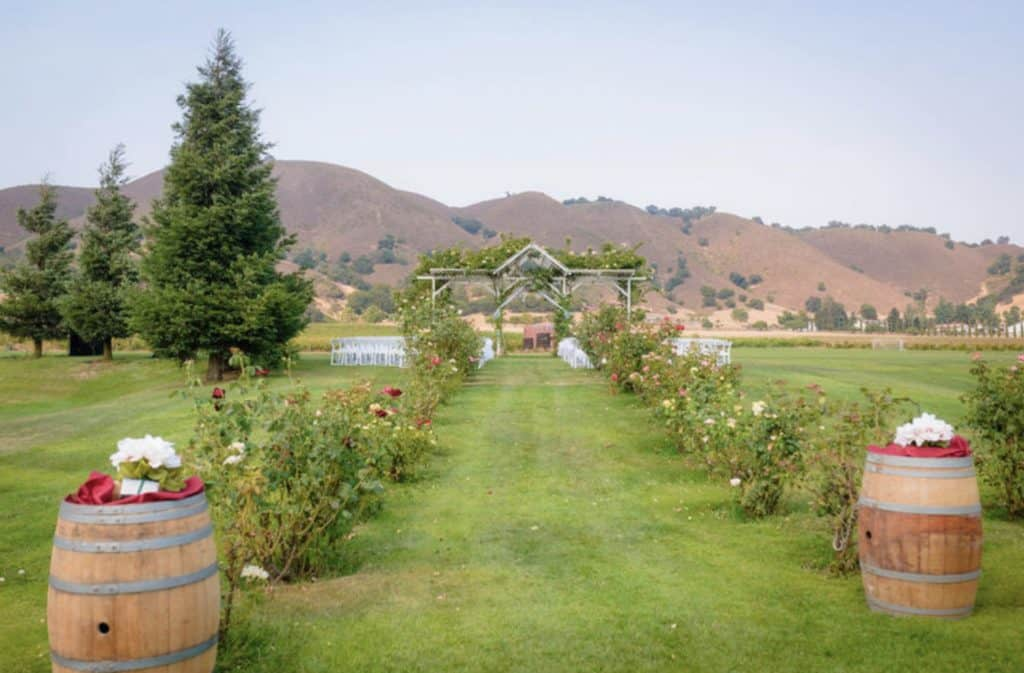 Kirign Cellars beautiful California wedding venue with barrels and trees lining the aisle