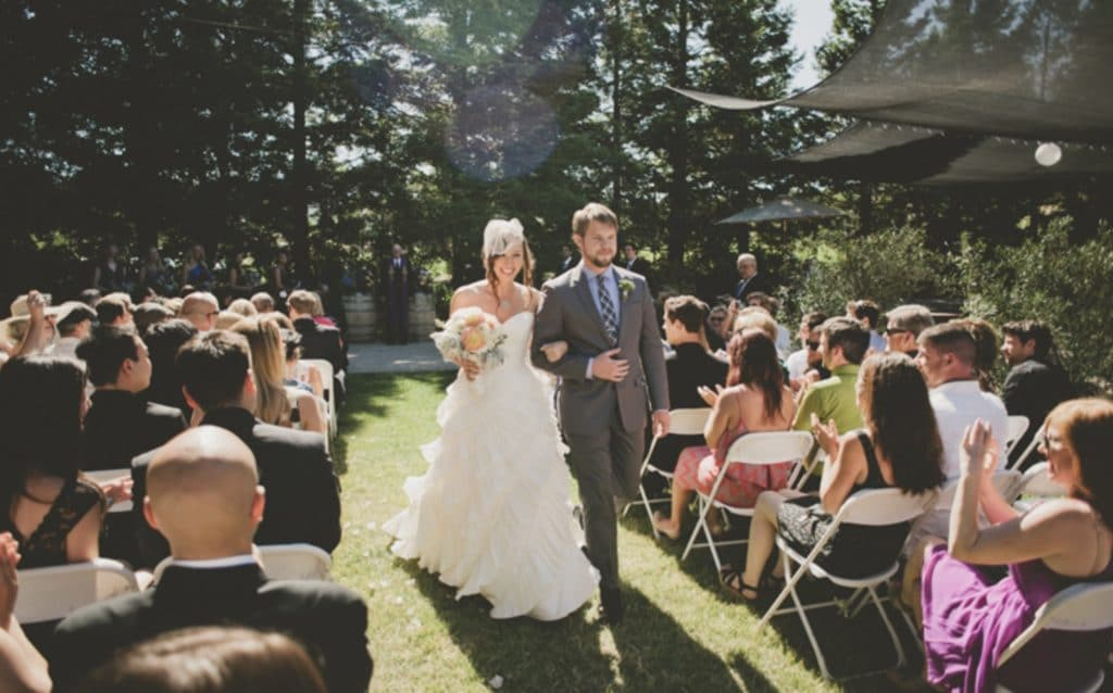 a couple and wedding guests at local California wedding venue